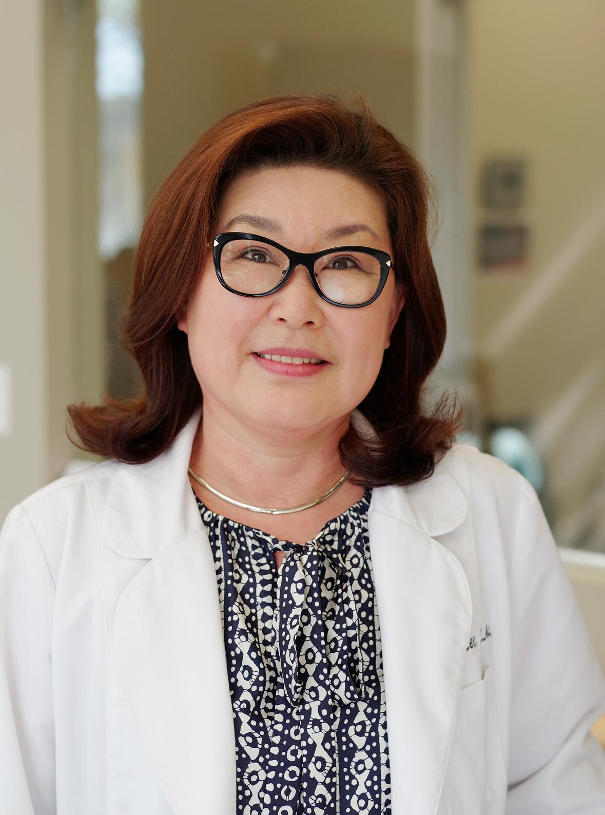 Christine Lee, L. Ac